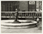 [Fountain with Figure and Small Boy]